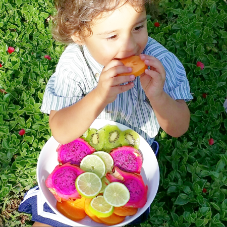 bodhi eating bowl of frui