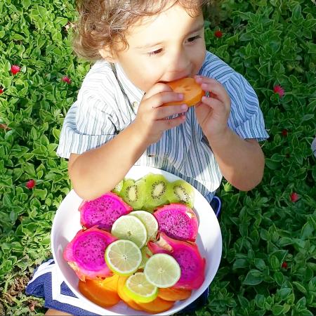 bodhi eating bowl of frui