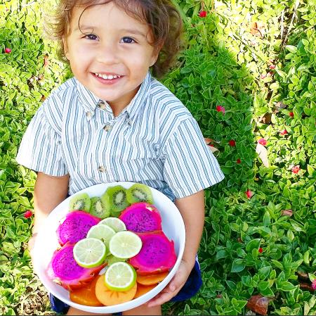 Bodhi holding mixed fruit
